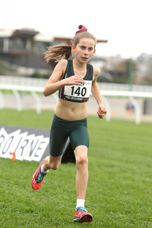 Isabella running post Sinding Larsen Johansson Syndrome- osgood schlatters disease